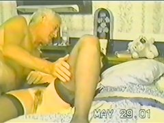 A brunette gets fucked by an old dude in a homemade scene