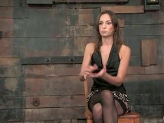 Amber Rayne gets pinched and fucked with a toy in a basement