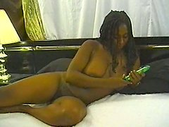 Black hussy moans sweetly while fucking her snatch with a toy