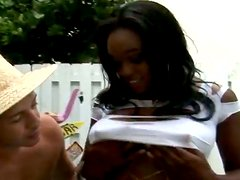 Busty ebony chick gets fucked by White dude in a backyard