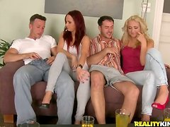 A blonde and a redhead get their vags smashed in a hot foursome scene