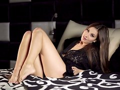 Heart-stopping beauty is moaning wild while playing with her wet slick pussy