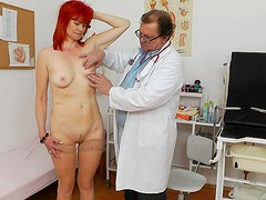 Milada is stretching her shaved pussy