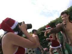 A few hot Santa girls enjoy ardent group banging on the poolside