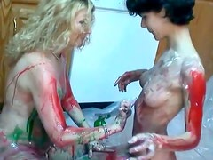 Skinny bitches got horny while licking off the sauce from their naked body