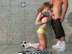 Sporty redhead babe Faye Reagan gives a head to her coach