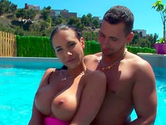 Busty Spanish chick in the swimming pool with her boyfriend