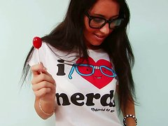 Lustful nerdy fingers her pussy tenderly and sensually