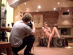 Silvia Saint takes her clothes off and poses at a photo shoot