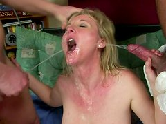 Cum-addicted mature woman participates in MMF threesome