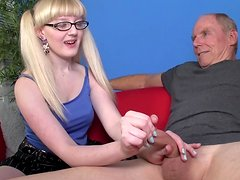 Pigtailed blonde is wanking a hard pole