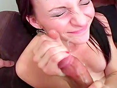 Brunette with big lips is sucking astonishing penis