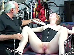 Doll with tattoo on her back is drilling her pussy