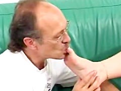 Gorgeous and brave daddy with glasses wants his bitch to do foot job