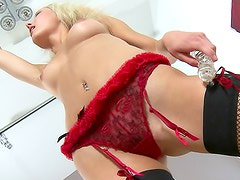 Hot blonde in red bra is playing with big dildo