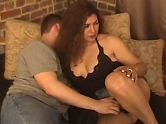 Chubby mature brunette shows her cock-sucking talent to some nerd