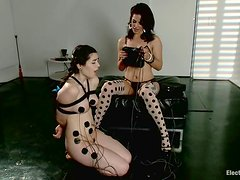 Kinky teen gets tied up and wired, being forced to eat her mistress's pussy