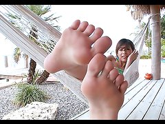 Naughty petite teen gives a footjob to a guy with a big cock