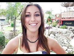 Sexy brunette gives one hell of a handjob outdoors