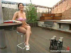 Ariel X enjoys some naughty machine sex in the yard