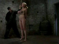 Blonde girl sucks a dick and get her tits twisted with ropes