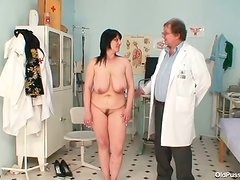 Mature woman with hanging boobs gets examined by a doctor