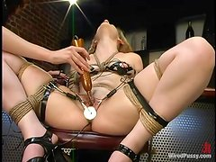 Aly enjoys being pulled by the pussy lips and fucked with a wired toy