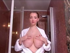 Cutie opens her robe and models big tits