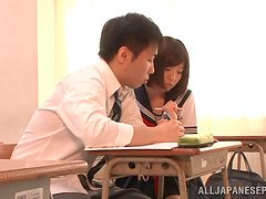 Japanese school girls gives a head to her classmate