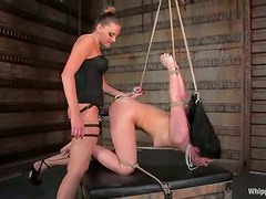 Cruel bitch is torturing this kinky brunette hard