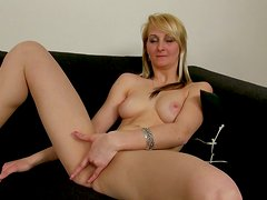 Blonde whore Katerina Gold fingers her pussy with great enthusiasm