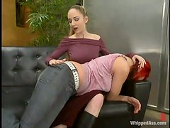 Redhead slut licks pussy and gets fucked with a strap-on