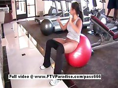 Pleasant Busty brunette flashing tits in the gym