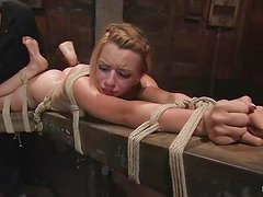 Horny blondie gets fingered in a tight bondage