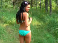 Tanned brunette is sucking black dick in the forest
