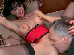 Zealous brunette MILF with fake tits gets her shaved snapper eaten