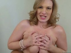 Busty blonde Vicky Vixen sucks a prick and gives a terrific titjob