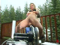 Harmony and Penny Flame play with fucking machine in a cottage