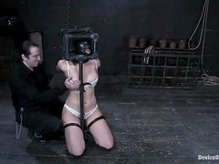 Penny Barber gets her ass fisted hard while being chained in pillory