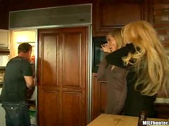 Two awesome blonde milfs enjoy sucking and riding a cock indoors