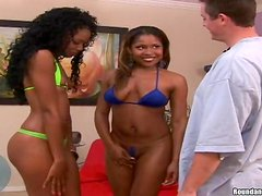 Two sizzling black chicks share a lucky dude's weiner