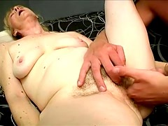 Granny blows his cock and lures him in her hairy muff