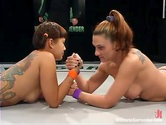 DragonLily fights with Toni Benz and fucks her pussy with a strapon