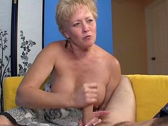 Cute short-haired mature is wanking a nice dick