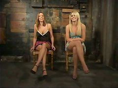 Two desirable blond babes are under some suspension