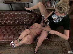 Maitresse Madeline punishes her servant with a strap-on