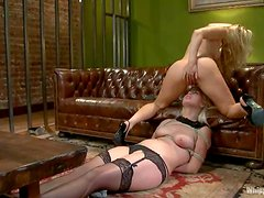 Two superb blonde babes have rough lesbian sex on a sofa
