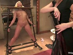 Maitresse Madeline beats Satine Phoenix before fucking her with a strapon