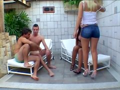 Blonde bitch enjoys group sex with two gays and a tranny