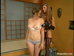 Kym Wilde teaches hot slut May-Anne a good lesson indoors